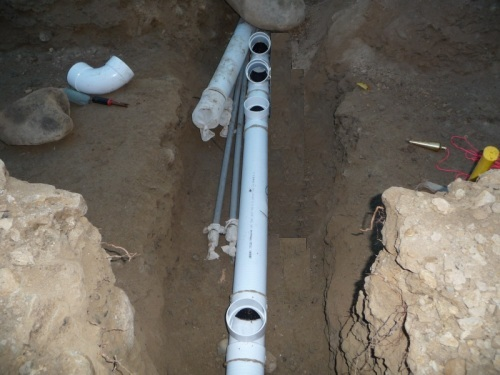 Drainage pipes under footing