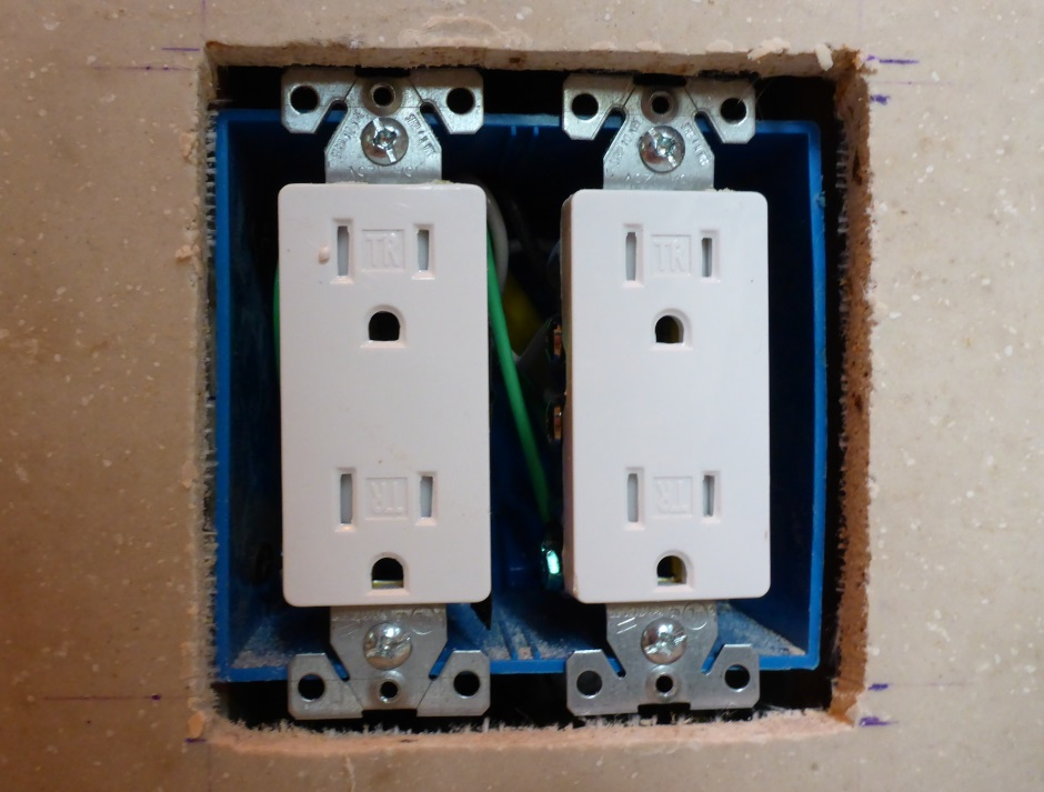 Drywall fits over electrical outlets