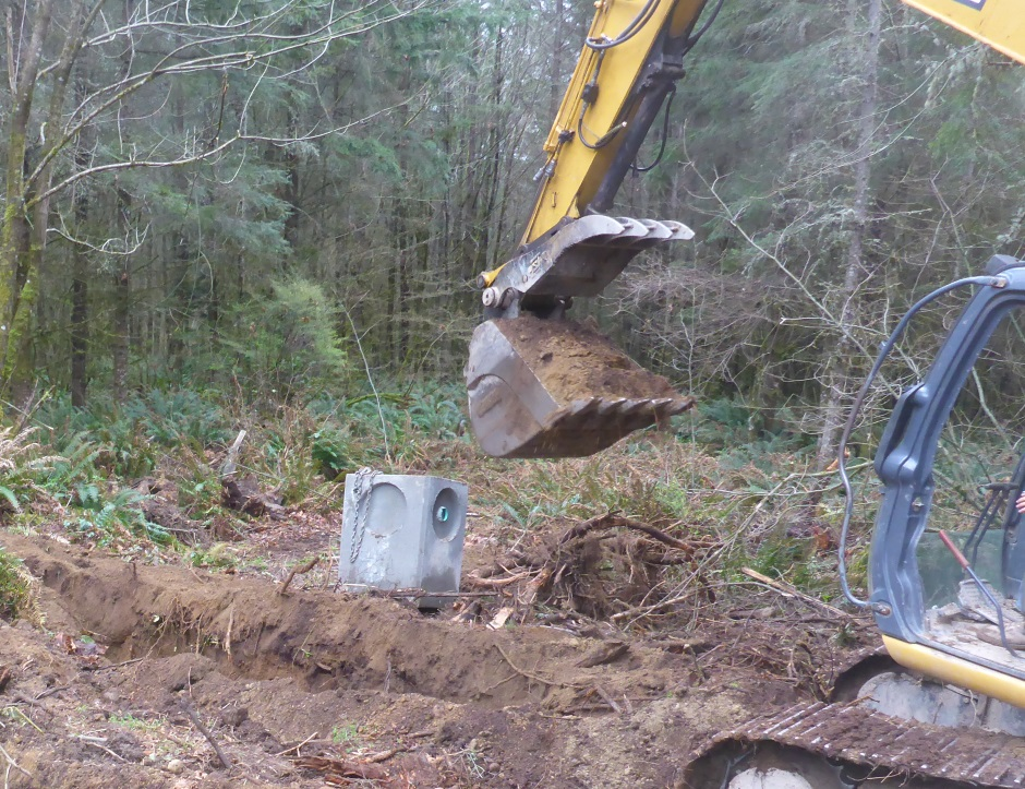 Excavator Digging Drainage Dispersal Trench