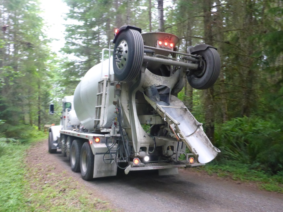 First Concrete Truck Reversing Up Drive