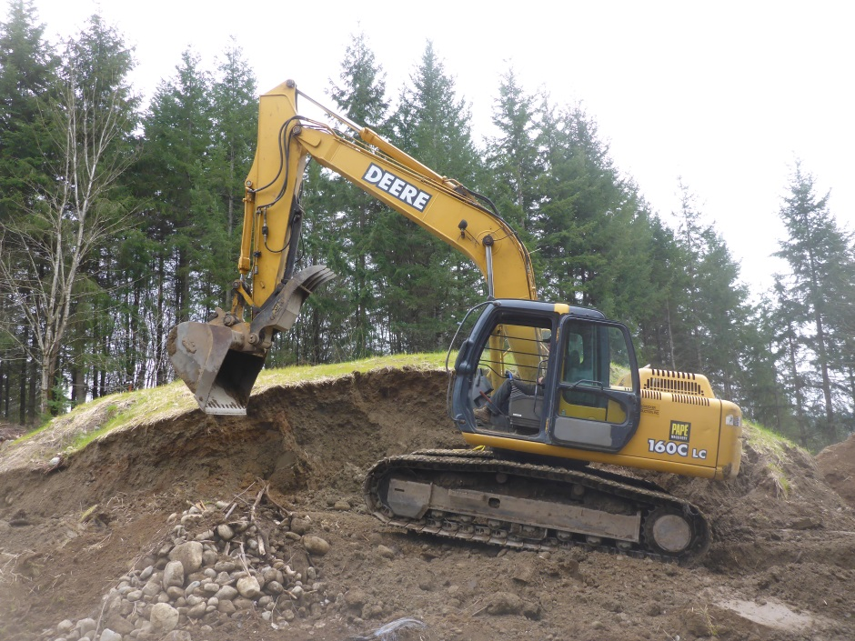 Moving Mountain Edge With Excavator