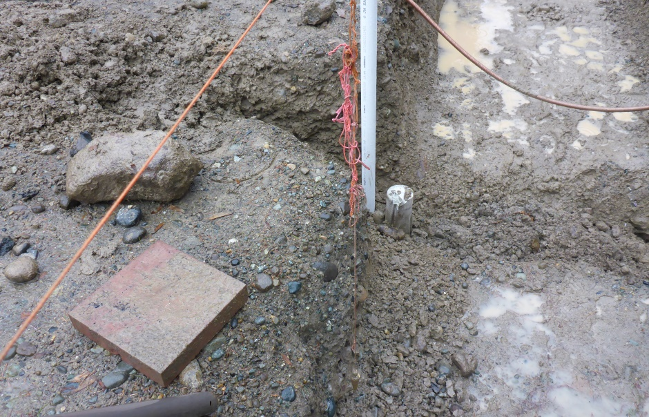 Plumb Bob Sets Footing Trench Edge