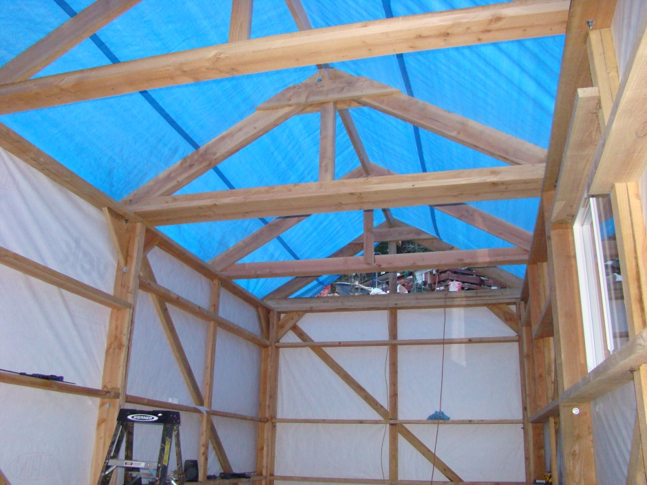 Shed inside roof trusses