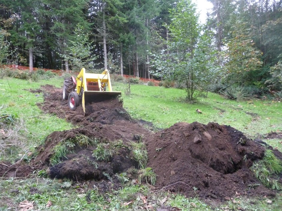Top soil removal with tractor
